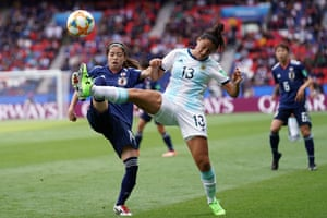 Argentina's defender Virginia Gomez vies with Japan's midfielder Yui Hasegawa.