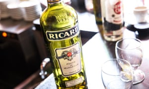 A bottle of Ricard on a table