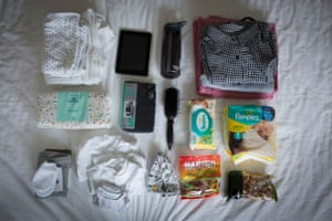 Joanna's bag: nappies, little white clothes for the baby, knitted trousers, snacks, clothes, towel, toiletries, TENS machine, maternity pads, iPad, water bottle, medical notes, blanket