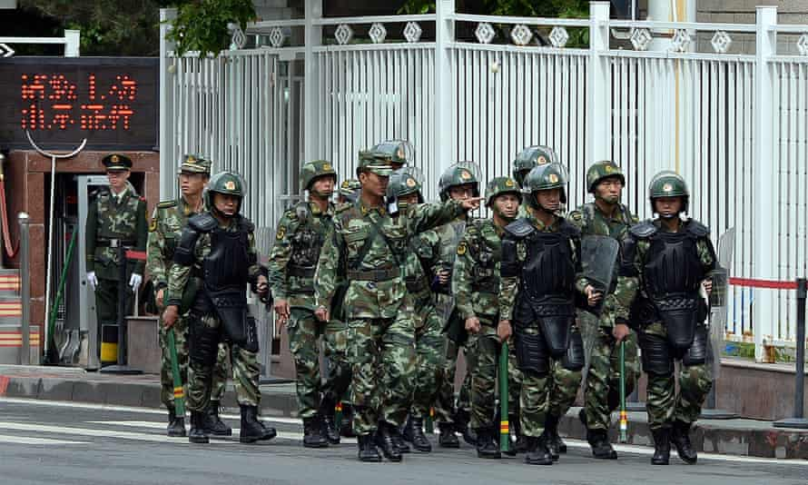 Chinese paramilitary police on patrol in Urumqi, capital of Xinjiang.