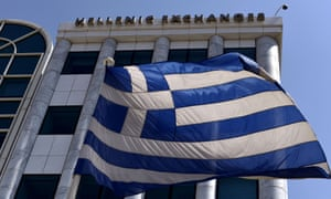 A Greek flag is pictured outside the Athens Stock Exchange in Athens.