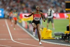 Kenya's Hellen Onsando Obiri celebrates after winning the women's 5,000m final.