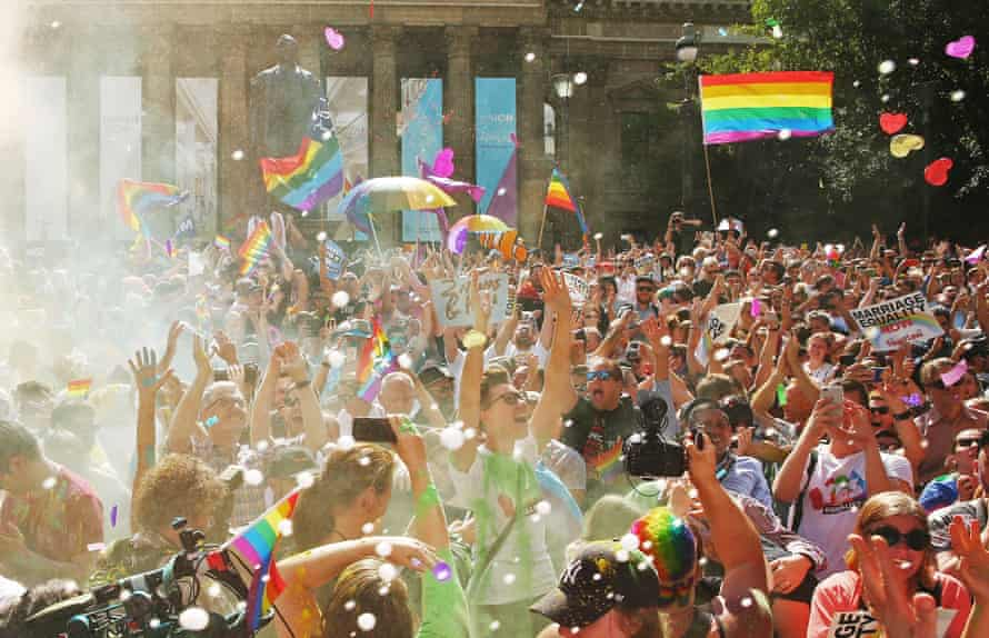 A crowd celebrates the results of the postal survey in front of the State Library of Victoria Wednesday.
