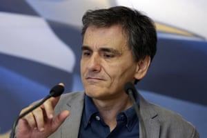 Euclid Tsakalotos<br>Greece's Finance Minister Euclid Tsakalotos checks the microphone before his speech during the handover ceremony of the outgoing Alternate Finance Minister Nadia Valavani and the incoming Tryfon Alexiadis in Athens, Monday, July 20, 2015. Greek banks finally reopened after three weeks of being closed but new austerity taxes meant that most everything was more expensive — from coffee to taxis to cooking oil. (AP Photo/Thanassis Stavrakis)
