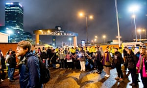 Protesters hold hands outside Billingsgate fish market in east London