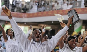 Worshippers raise their hands at the Pure Fire Miracle Church in Accra, Ghana.
