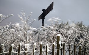 The Angel of the North sculpture, designed by Antony Gormley, in Gateshead, Tyne and Wear, during the night after heavy snow blanketed much of the north of England