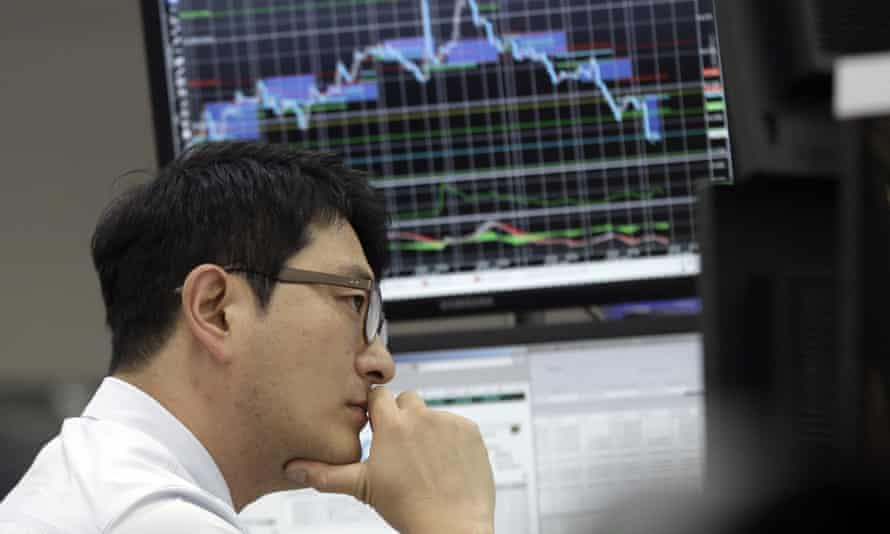 A South Korean currency trader watches monitors during September's Asian stock sell-off.