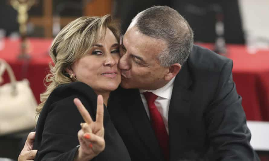 Daniel Urresti, who is favorite to become mayor of Lima, kisses his wife at the end of his trial.