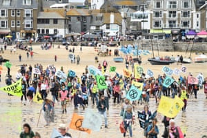 """Extinction Rebellion activists taking part in the """"Sound The Alarm"""" march in St Ives, Cornwall."""