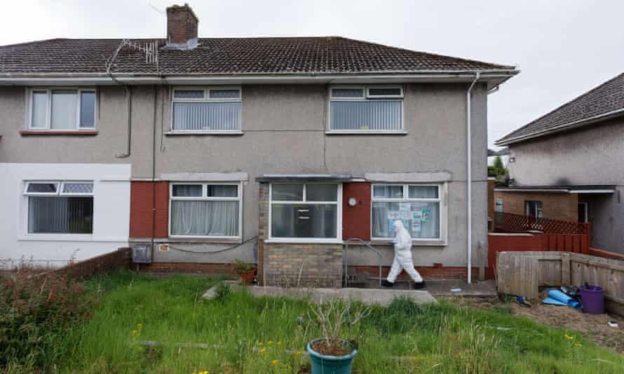 Police forensics officers at the house in Sarn, south Wales