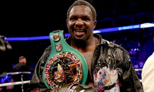Dillian Whyte celebrates victory after defeating Oscar Rivas on points in the WBC interim heavyweight title fight at the O2 Arena