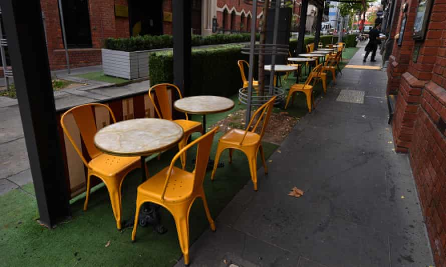 Empty seats are seen at a Cafe in Melbourne, Australia, 27 May 2021 ahead of a seven day lockdown.