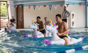 Team bonding … Kieran Trippier, Jesse Lingard, Jordan Pickford and Harry Maguire play with inflatable unicorns.
