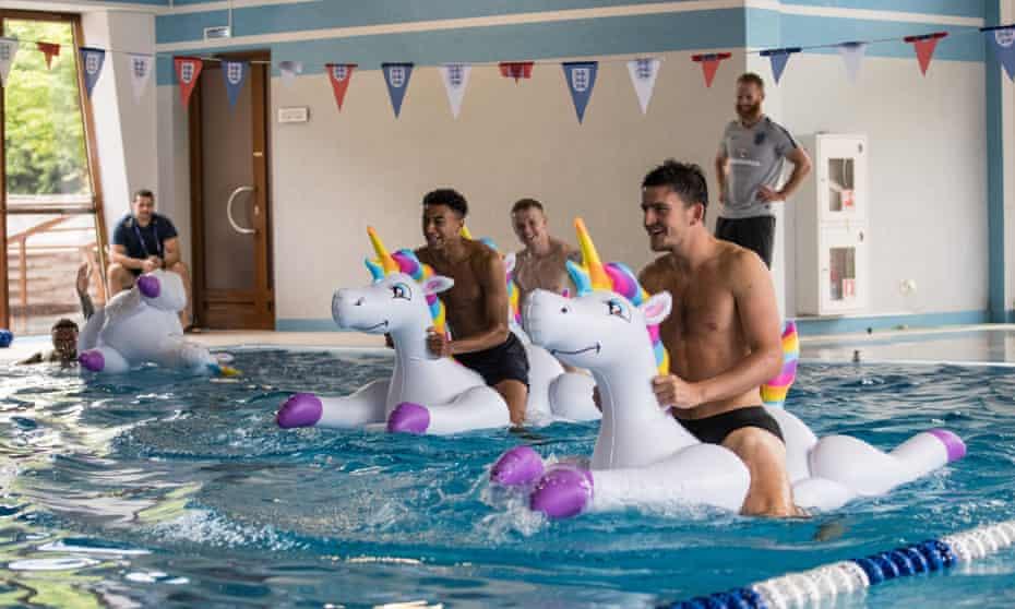 Team bonding … Kieran Trippier, Jesse Lingard, Jordan Pickford and Harry Maguire play with inflatable unicorns.