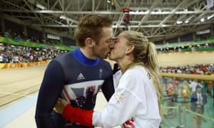 Jason Kenny kisses partner Laura Trott after winning the men's keirin cycling final.