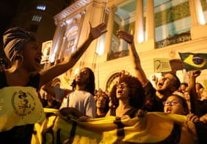 """Thousands of students marched through downtown Rio with placards reading: """"Education isn't an expense, it is an investment""""."""