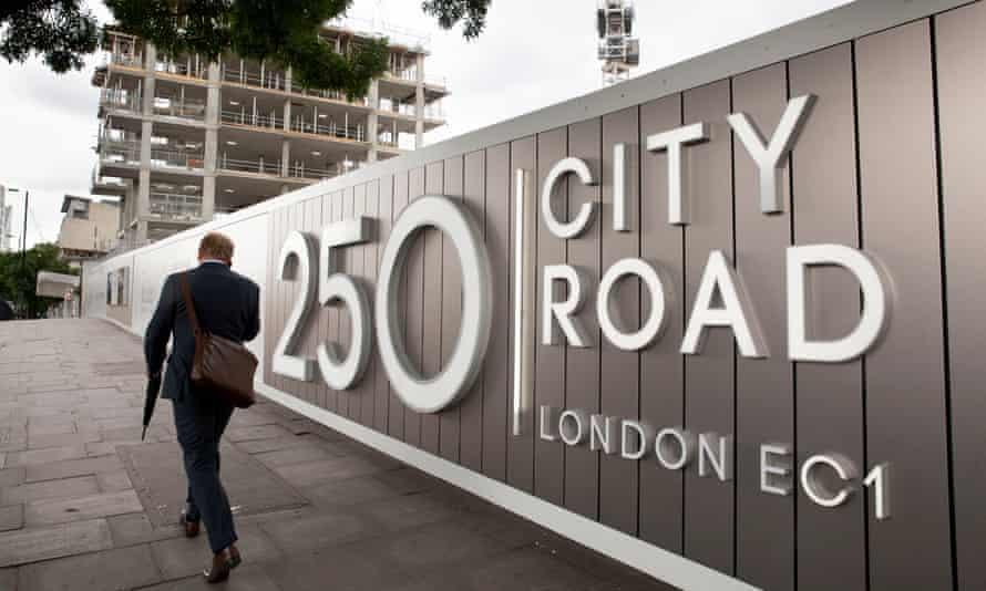A City worker walks past a Berkeley Group development in Islington, London