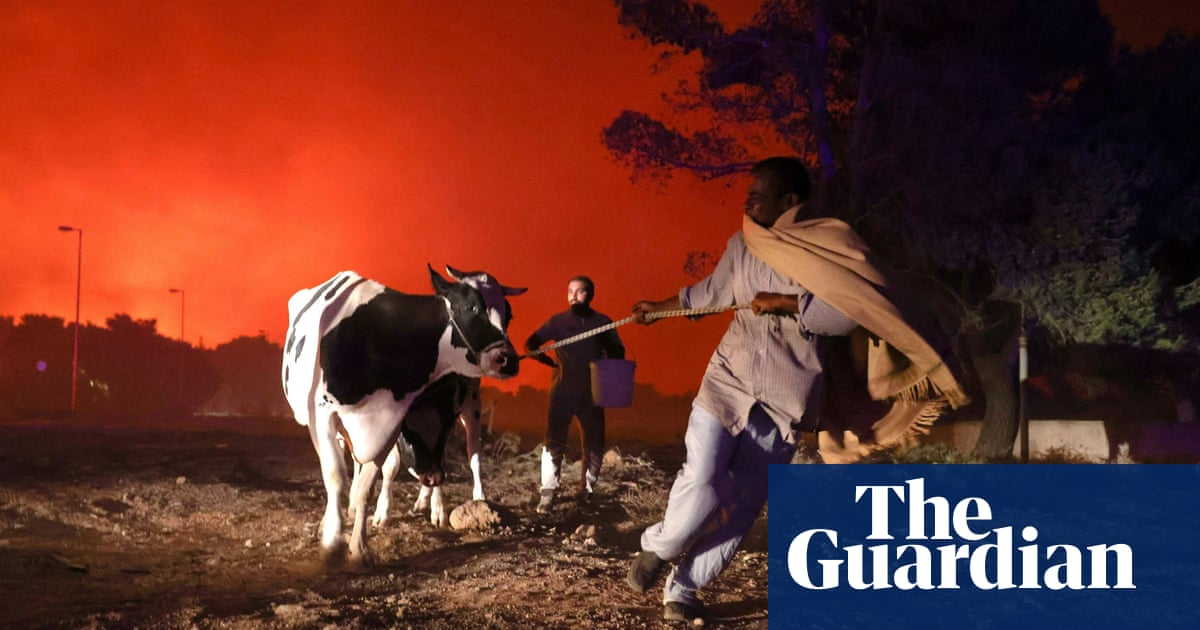 'Greece has burned': thousands flee Athens suburb as wildfire spreads – video