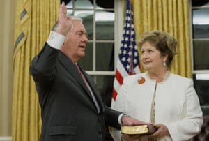 Rex Tillerson is sworn in as US secretary of state while his wife, Renda St Clair, holds the Bible.