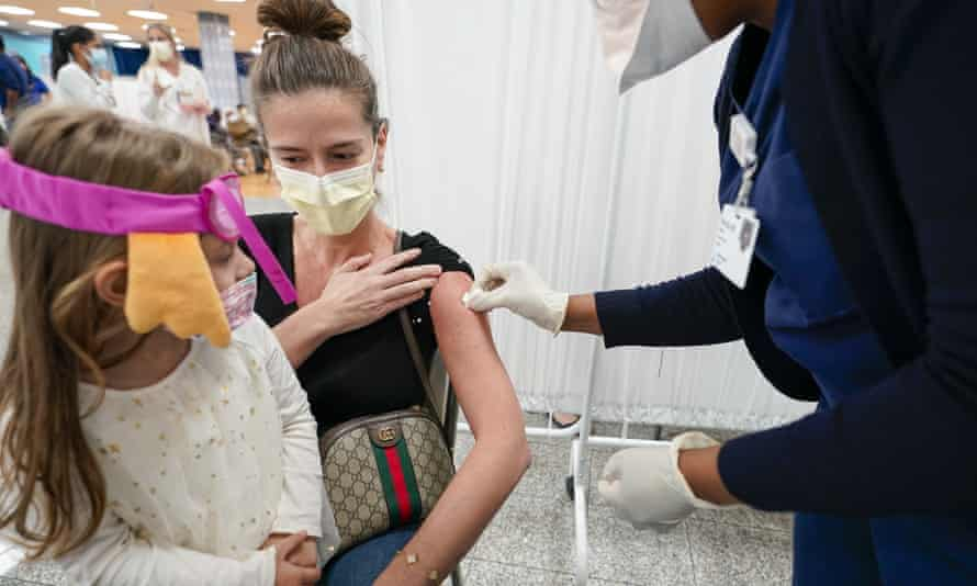 A woman receives the J&J vaccine in New York on Thursday.
