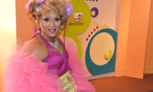Honey Mahogany, a drag queen in San Francisco, reads stories to children at a local Drag Queen Story Hour event at the city's public library.