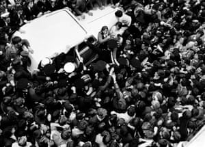 Arriving in Dublin in his Rolls Royce Best is mobbed by some of the 15,000 strong crowd in August 1970