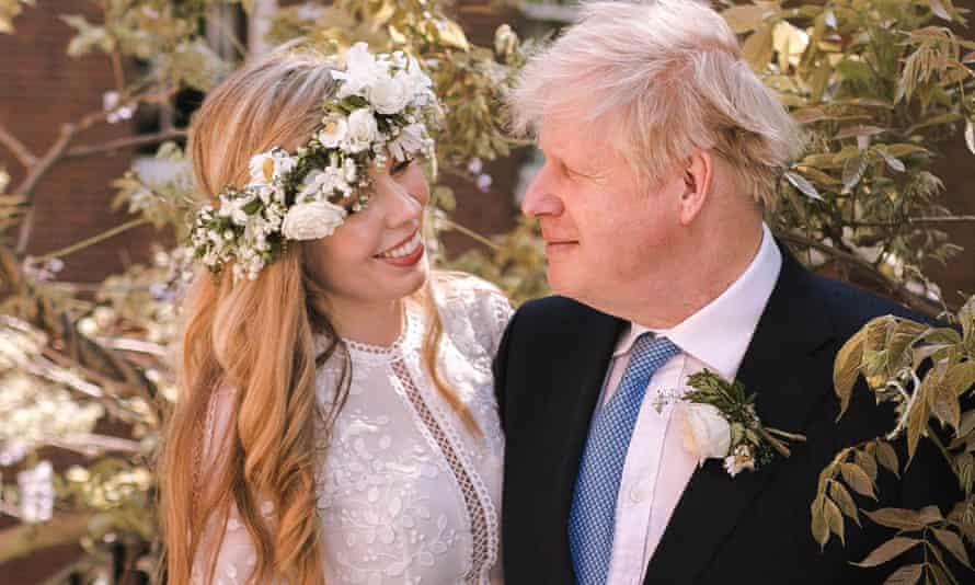 Boris Johnson poses with his wife Carrie following their wedding at Westminster Cathedral on 29 May.