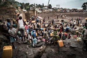 People fetch water in the Funu district of Bukavu, where there is no access to running water