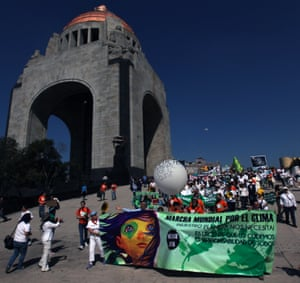 Protesters next to the Monument to the Revolution in Mexico City