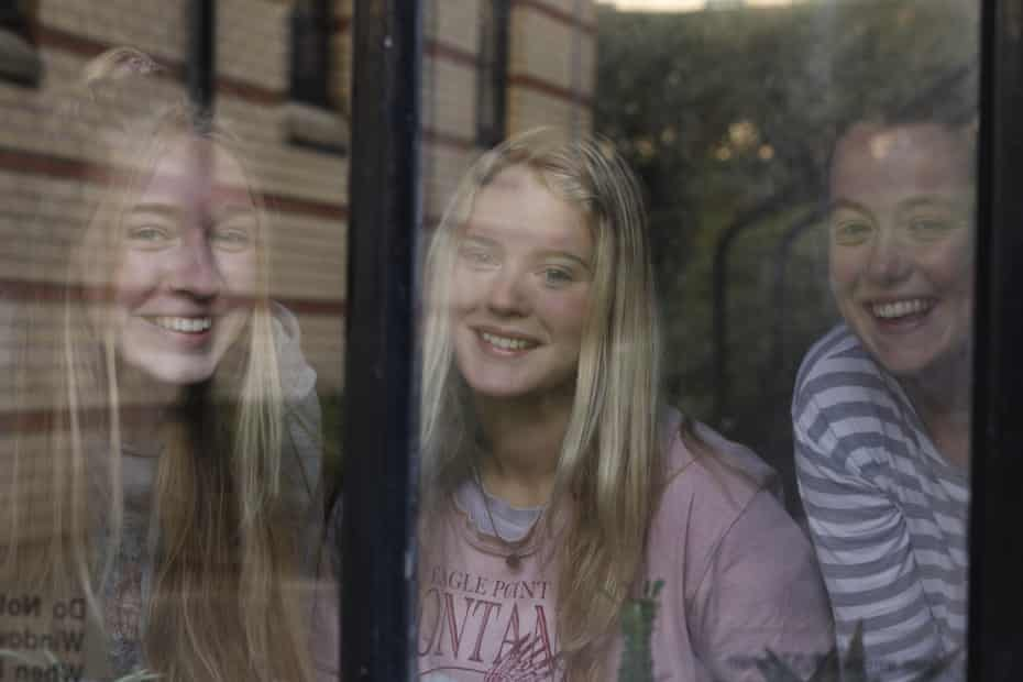 Students behind a window