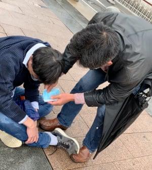 A heartbroken man on street in Wuhan.