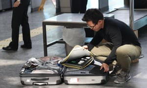 man at airport with electronic device
