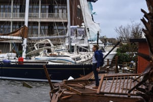 A man stands on the broken dock to check his boat during Hurricane Sally in downtown Pensacola.