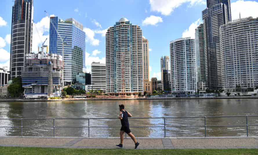 A man jogs beside the Brisbane River at Kangaroo Point in Brisbane