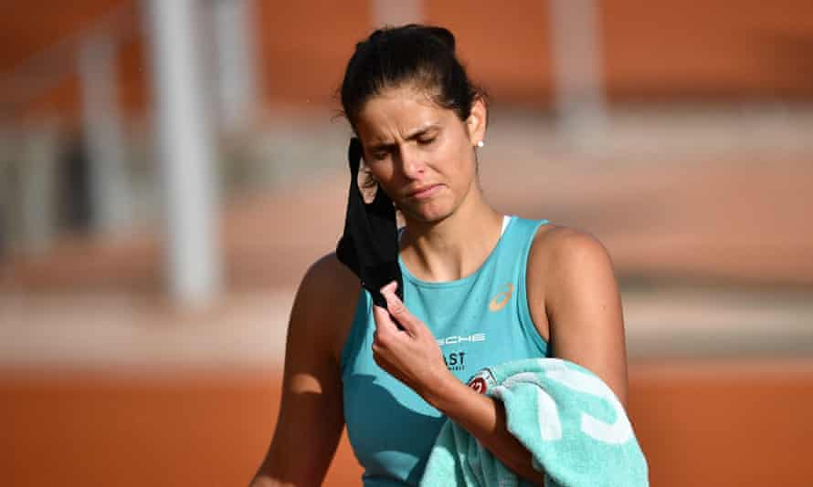 Julia Görges removes her face mask while competing at the French Open in October.