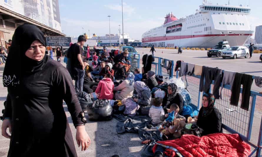A migrant family rests in the port of Piraeus, where more than 1,500 migrants and refugees are staying.