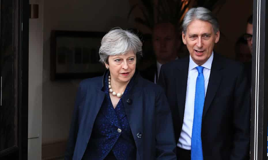 Prime minister Theresa May and the chancellor, Philip Hammond.