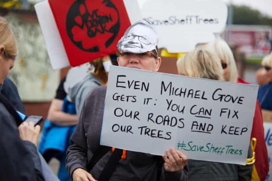 A placard cites Michael Gove.