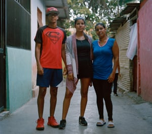 The Melean family, standing outside their home