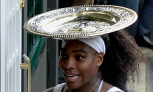 Serena Williams celebrates with the trophy on her head after winning against Garbine Muguruza.