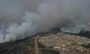 An aerial photo shows wildfires near neighborhoods in Fort McMurray, Alberta, Canada on Wednesday.