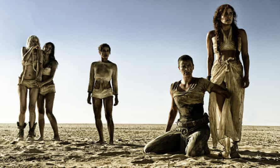 Desert warriors ... Charlize Theron (kneeling) as Imperator Furiosa alongside fellow castmembers Abbey Lee, Courtney Eaton, Zoe Kravitz and Riley Keough in Mad Max: Fury Road.