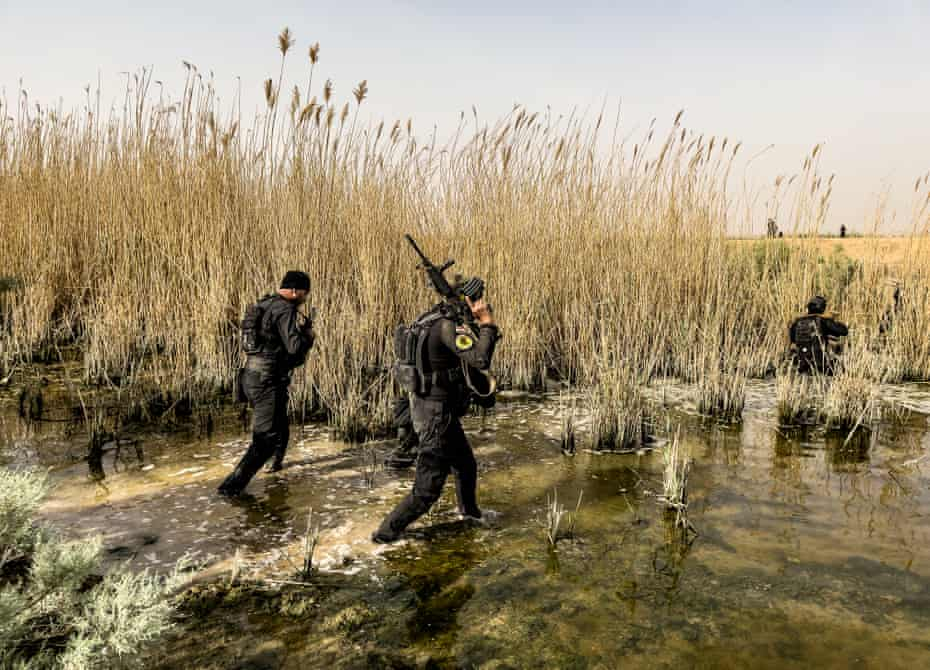 Troops comb through irrigation canals during search operations targeting Isis.
