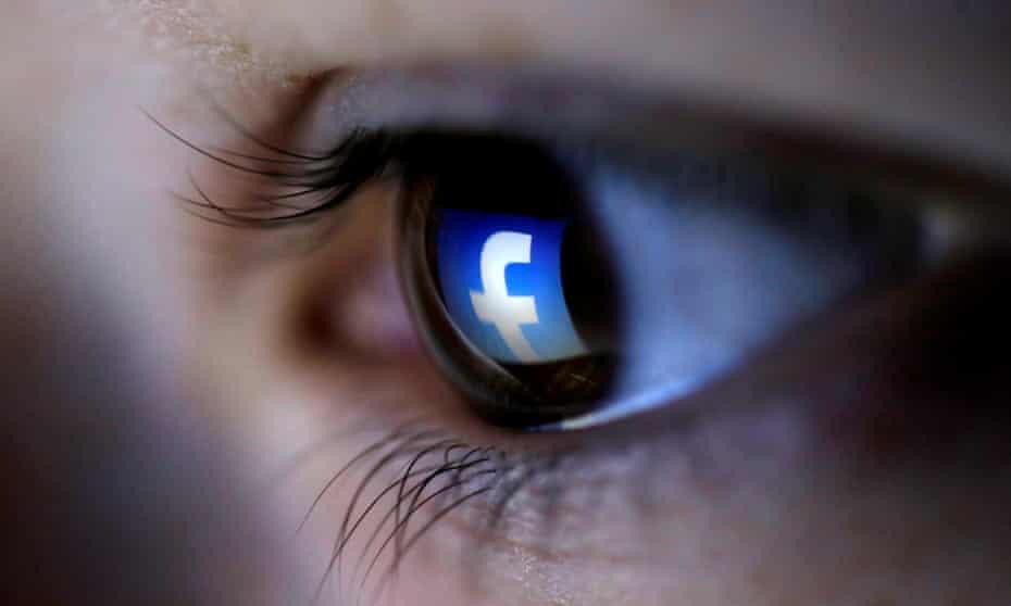 Facebook logo reflected in a woman's eye