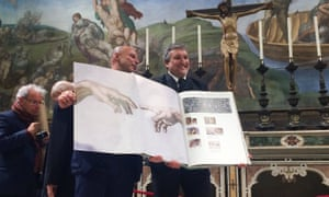 Sweet Sistine: the book includes Michelangelo's The Creation of Adam at 1:1 scale.