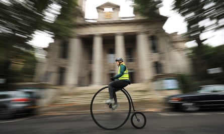 A woman on a penny farthing