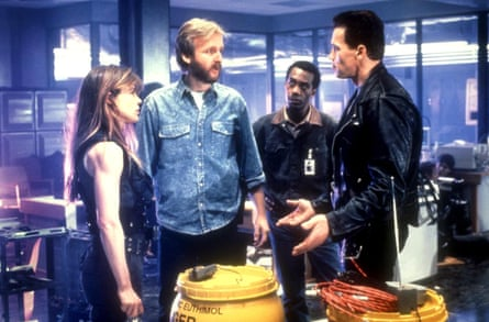 Linda Hamilton on the set of T2 with, from left, director James Cameron, Joe Morton and Arnold Schwarzenegger.