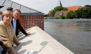 Angela Merkel and Stephan Weil, Lower Saxony's premier, observe the swollen Elbe in 2013.