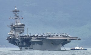 The USS Theodore Roosevelt (CVN-71) is pictured as it enters the port in Da Nang, Vietnam, March 5, 2020.